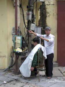 Peluquero en la calle.